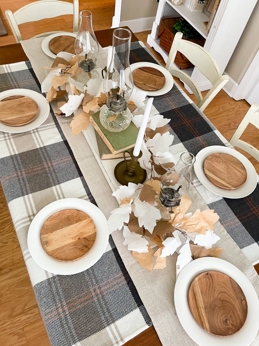 Wooden plate on white plate for Thanksgiving table